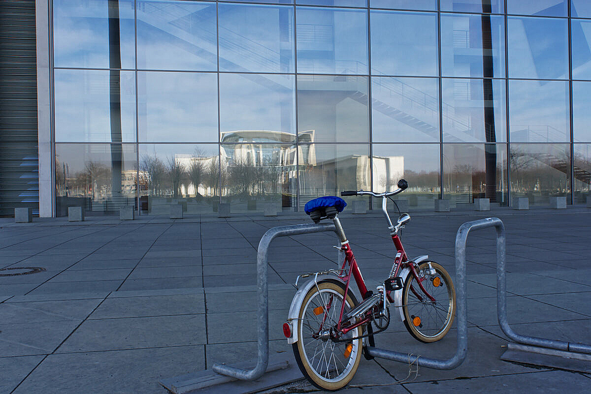 Bicycle parked in front of the Bundestag in Berlin
