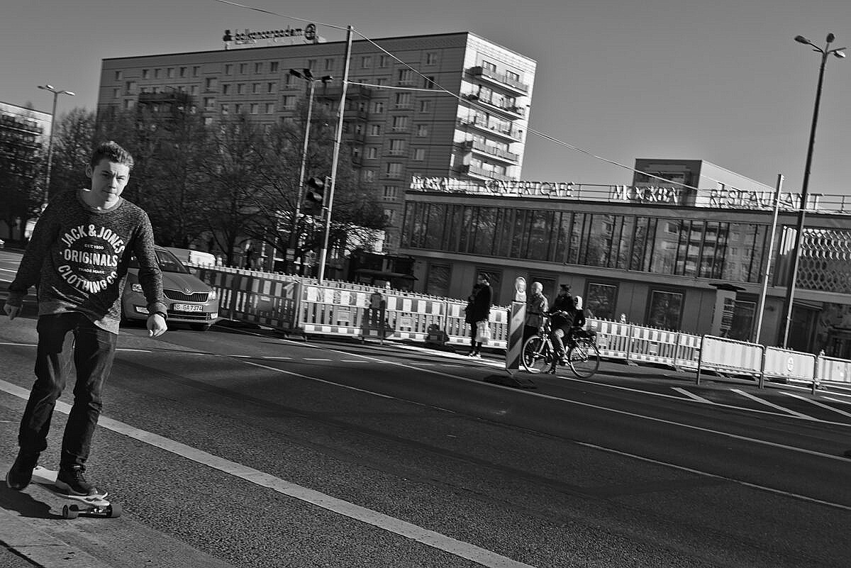 Karl-Marx-Allee, Berlin, with a kid of a skateboard.