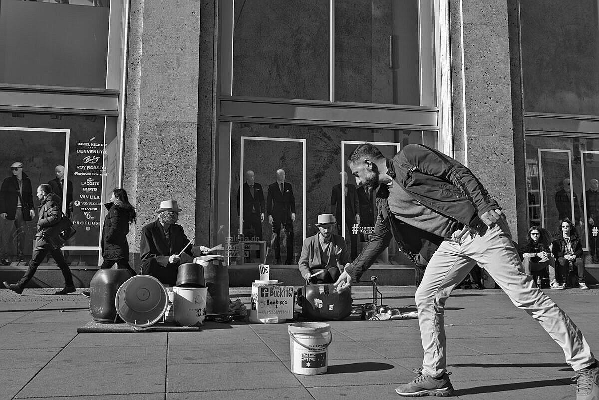 Alexanderplatz, Berlin, with street musicians and a man leaving them a bit of money