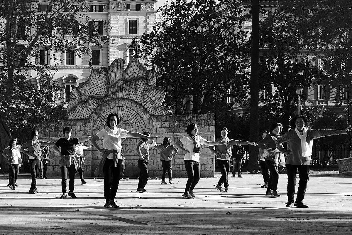 Group of women excercising in a park on the Esquiline Hill in Rome
