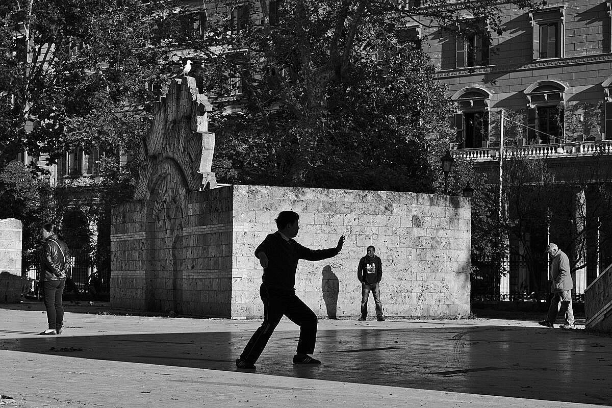 Man practising Tai Chi in a park on the Esquiline Hill in Rome.