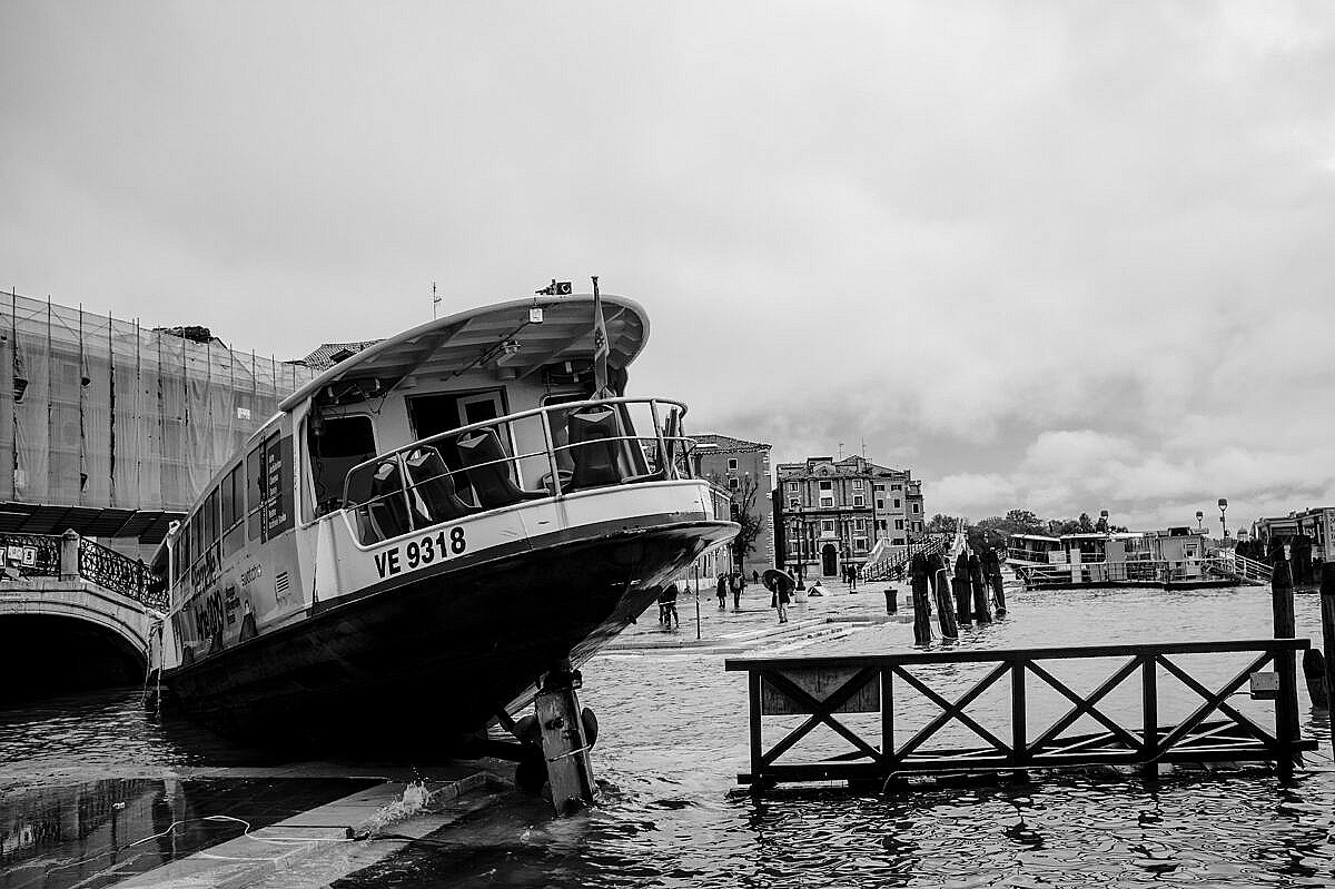 High tide - Venice under water - wrecked vaporetto