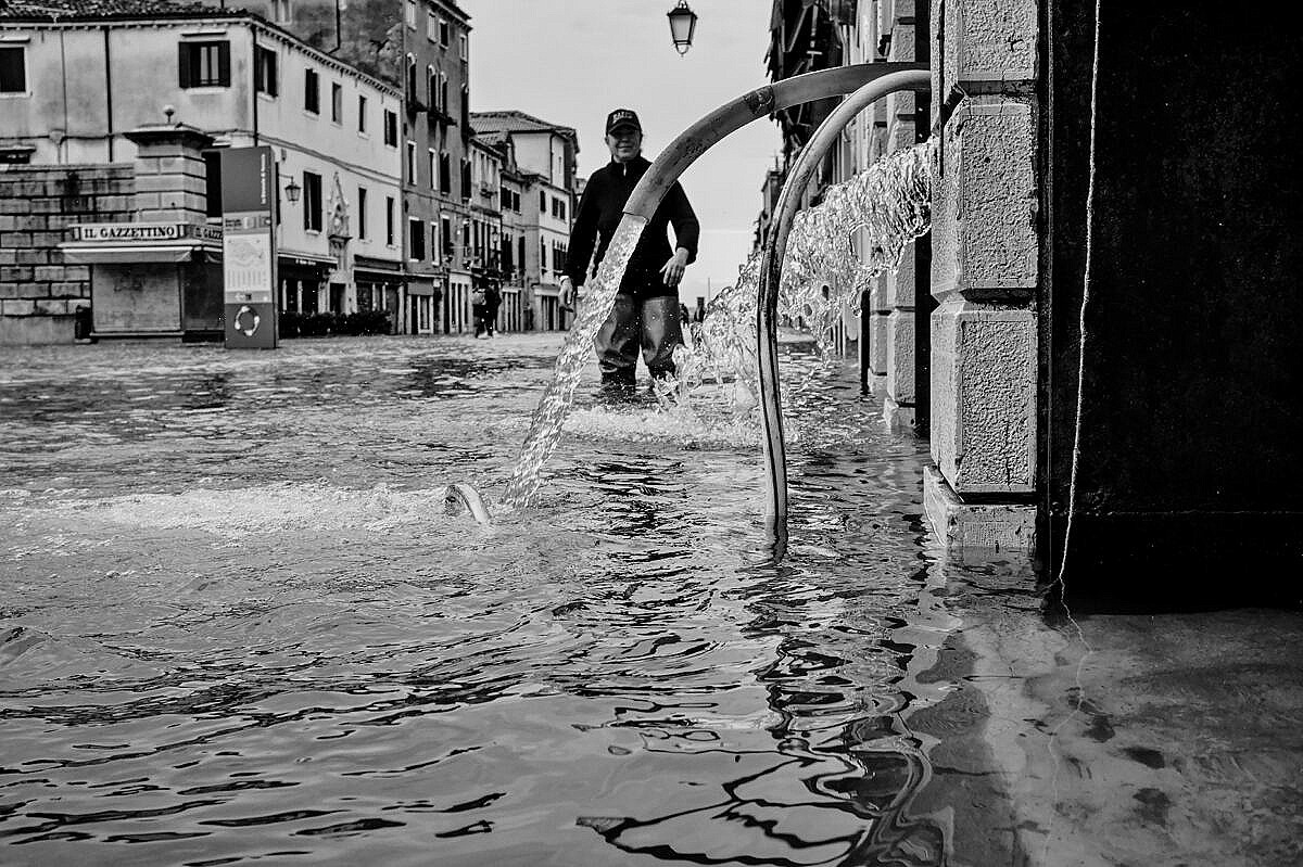 High tide - Venice under water - a bar pumping out water