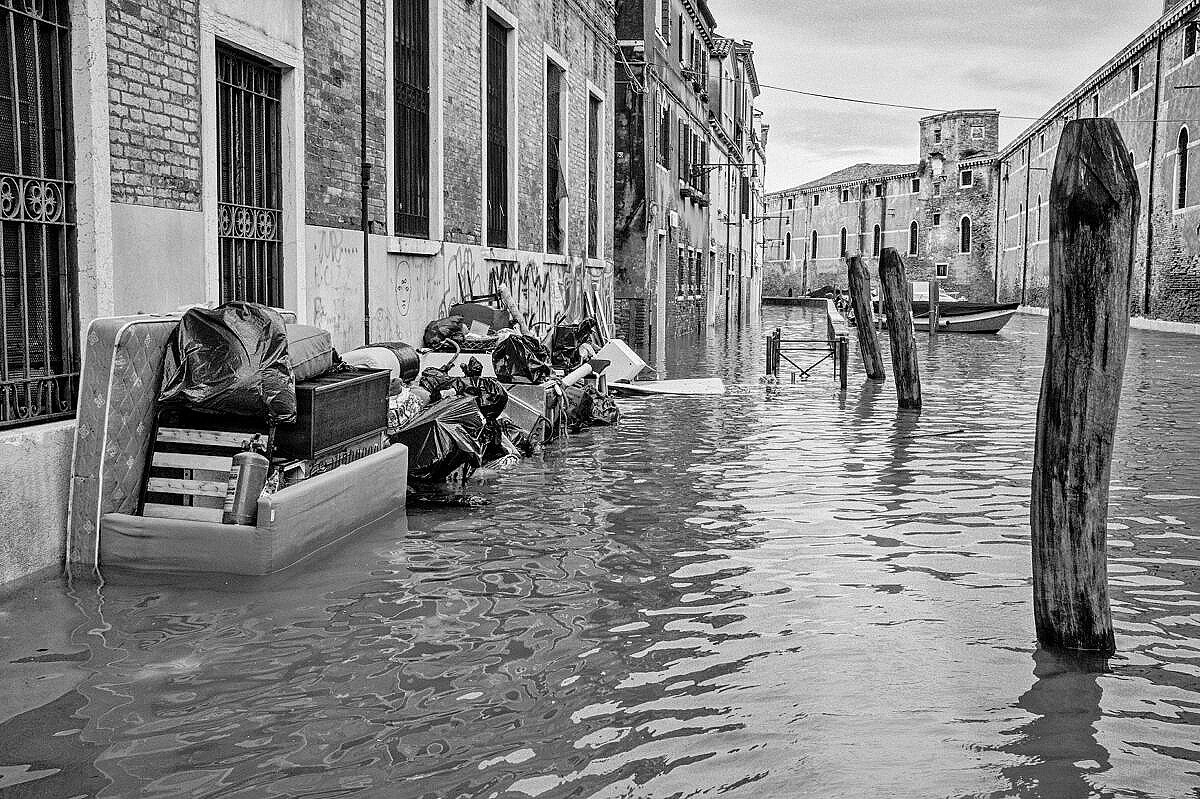High tide - Venice under water - Fondamenta de la Tana with debris piled up
