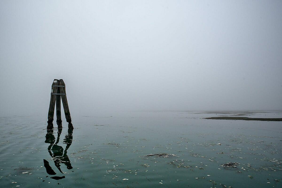 The Venetian lagoon on the fog - briccola with reflection
