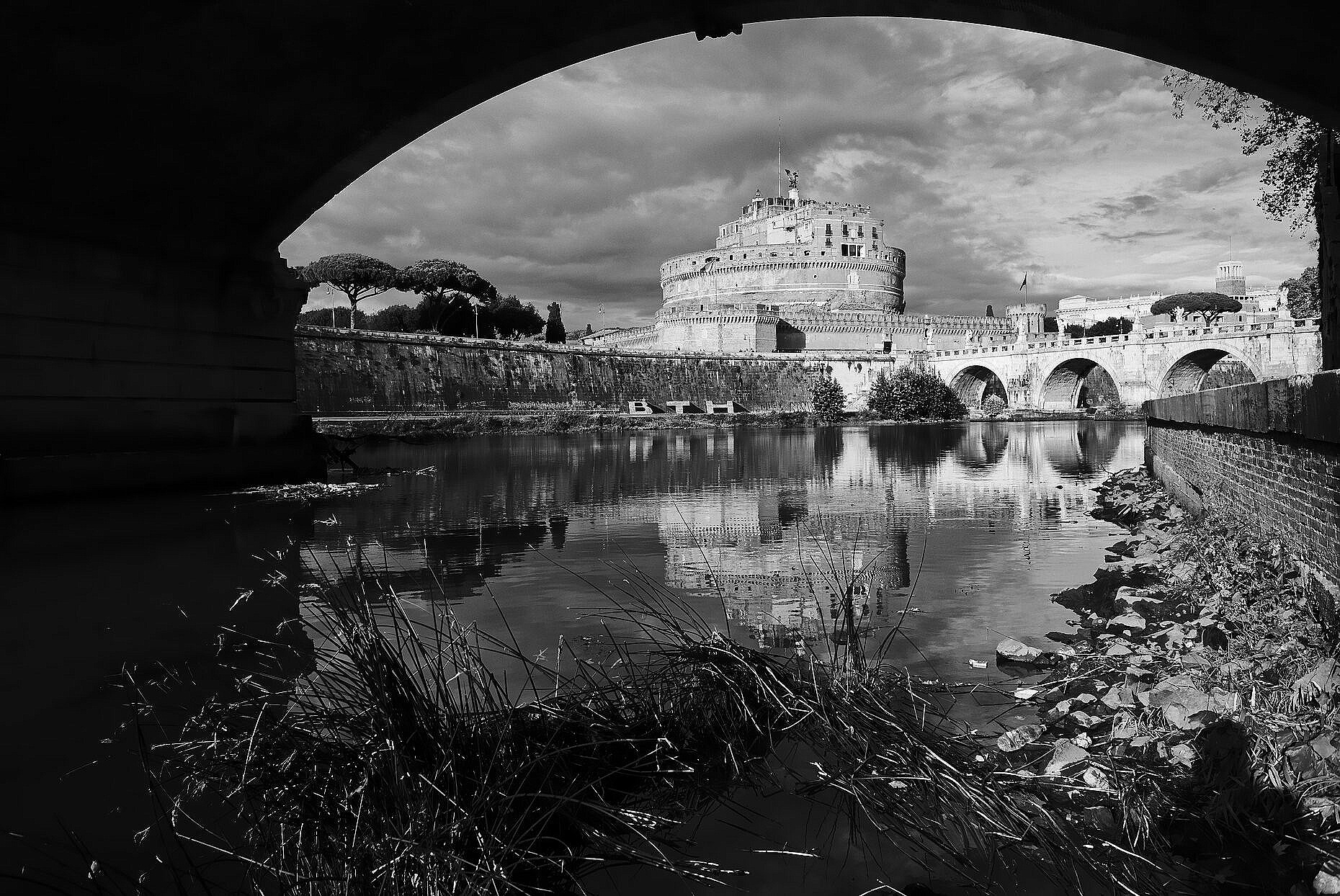 Castel Sant'Angelo in Rome seen from below the Ponte Vittorio Emanuele II on the Tiber river