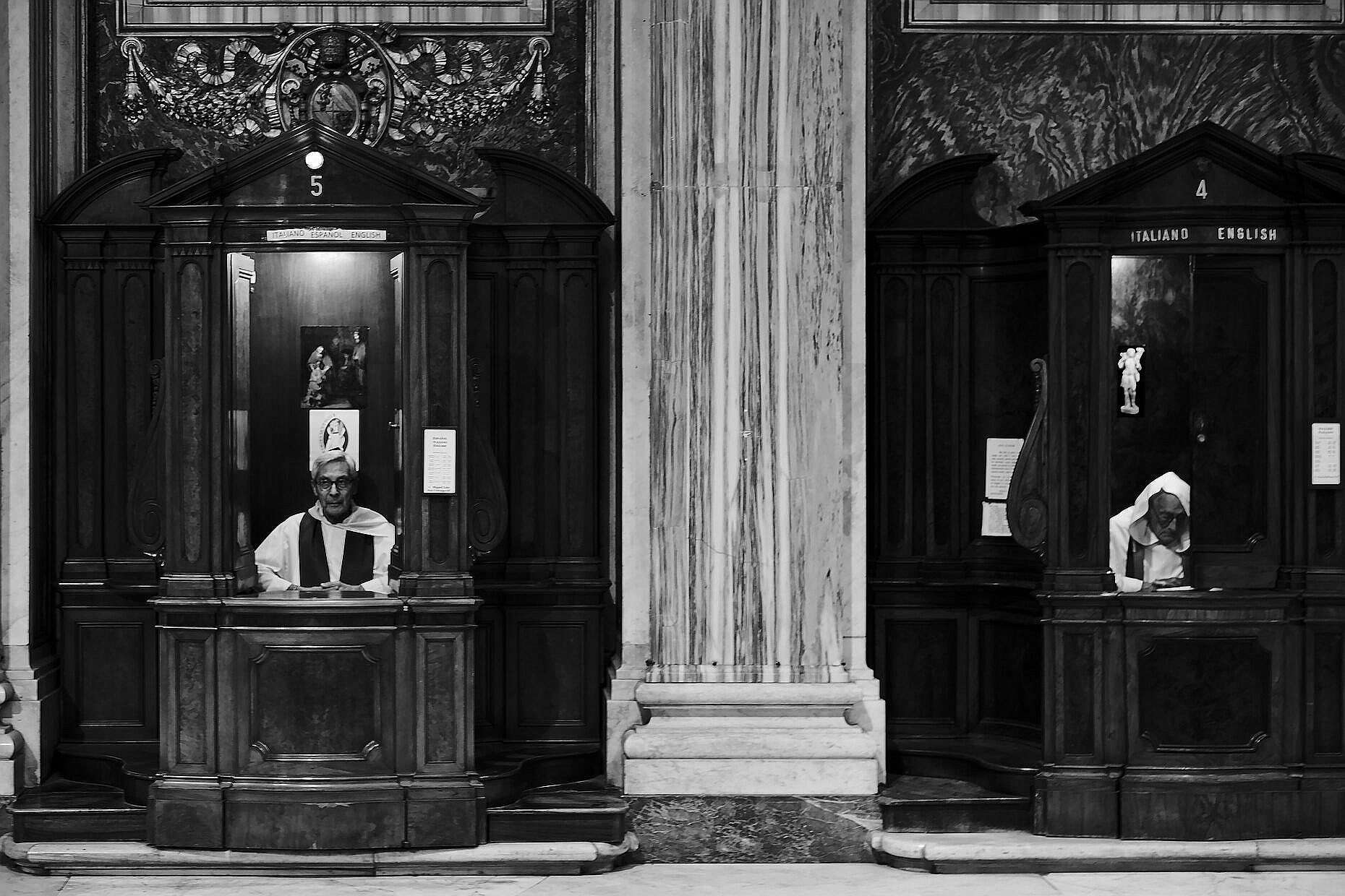 Priests taking confessions in the Basilica Santa Maria Maggiore in Rome.