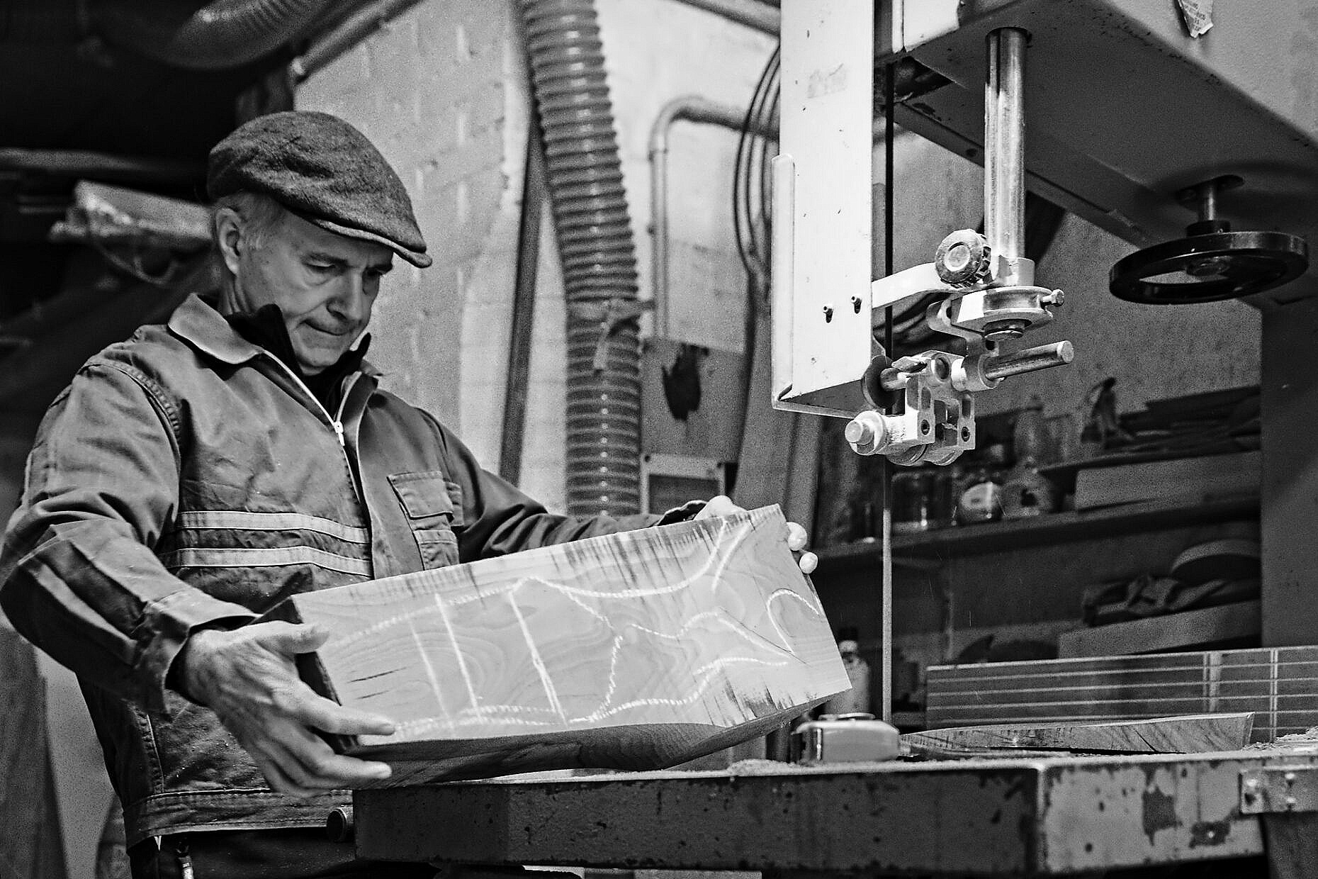 Oar maker (remer) Saverio Pastor contemplates a block of wood for a forcola. This is the hardest part of making a Venetian oarlock.
