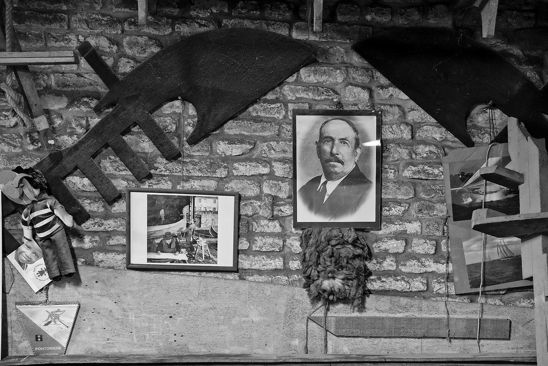 Photo of the founder Domenico Tramontin and other memorabilia on the wall of the squero Tramontin